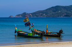 Longtail boat. Available for rent in Patong beach Stock Photo