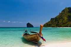 Longtail boat on beach. Longtail boat on one of exotic Krabi islands beach in Thailand royalty free stock image