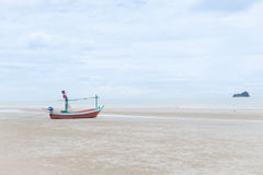 Longtail boat on the beach. Stock Photo