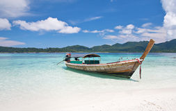 Longtail boat and beautiful beach with white sand Royalty Free Stock Photos