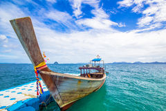 Longtail boat and blue dock. Blue dock and longtail boat on andaman sea Royalty Free Stock Photo