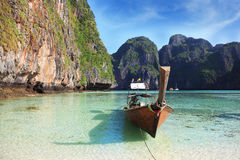 The Longtail boat in the clear water bay Stock Photography