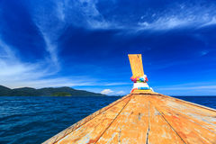 Longtail boat on crystal clear sea at tropical beach Royalty Free Stock Photos