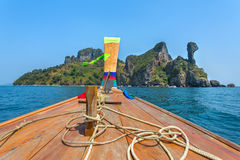 Longtail boat driving to the Chicken island. In Andaman sea, Thailand stock images