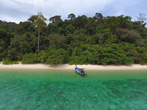 Longtail boat and empty tropical beach. Aerial view on longtail boat and empty tropical beach in Thailand Royalty Free Stock Photos