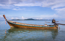 Longtail boat in Ko Lanta, Thailand. Longtail boat waiting for passengers on beautiful Ko Lanta island, Thailand. The clouds and the boat frame a piece of blue Stock Images