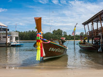 Longtail boat, Koh Lanta, Krabi, Thailand. A long tail boat sits moored up at the beach in Saladan, Koh Lanta awaiting tourists to board and cross the Klong ( Royalty Free Stock Photography