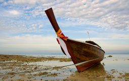 Longtail boat in low tide. Thailand Stock Images