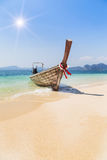 Longtail boat mooring on the tropical beach in the andaman sea. Krabi Thailand Royalty Free Stock Photography