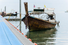Longtail boat park at floating pier Stock Image