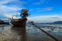 Longtail boat parked. Shallow due to sea water decreased royalty free stock photo