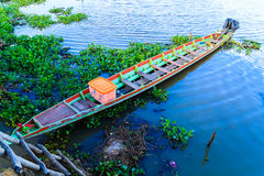 The longtail boat in the river. Stock Image