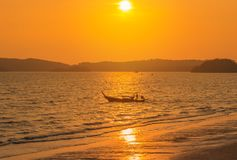 Longtail boat sailing in tropical andaman sea during sunset time Royalty Free Stock Photography