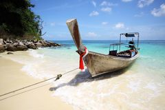 Longtail boat and sea. Clear water, blue sky Royalty Free Stock Photos