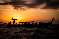Longtail boat in sea at sunset in Thailand Stock Image