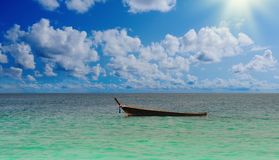 Longtail boat on the sea tropical beach Royalty Free Stock Images