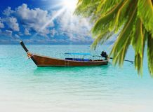 Longtail boat on the sea tropical beach Stock Image