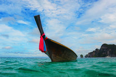 Longtail boat on the sea tropical beach Stock Photos
