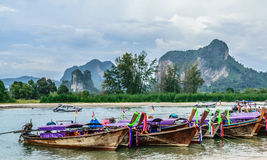 Longtail boat at the shore. Shore of aonang beach krabi  thailand Stock Photo