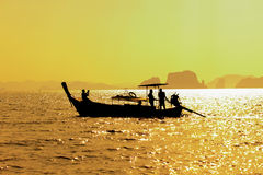 Longtail boat on sunrise. On the coast of Andaman sea in Thailand Stock Photography