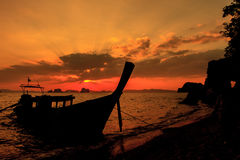 Longtail boat on sunrise. On the coast of Andaman sea in Thailand Stock Photo