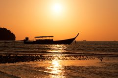 Longtail boat and sunset Royalty Free Stock Photography