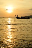 Longtail boat and sunset Royalty Free Stock Image