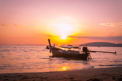 Longtail boat and sunset. Andaman Sea, Thailand,Tropical beach, long tail boats, Thailand,Long tail boats on beach,Andaman Sea,krabi,thailand,sunset,island Stock Photo