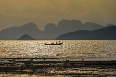 Longtail-boat during sunset at Koh Yao Noi, Thailand royalty free stock photography