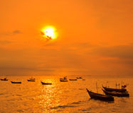Longtail boat in the sunset Royalty Free Stock Photography