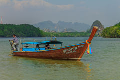 Longtail boat in Thailand. Krabi, Thailand - January 25, 2014: Longtail boat in Krabi Thailand, with Kanab Nam Mountains in the background Royalty Free Stock Photo