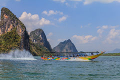 Longtail boat in Thailand. Longtail boat in Krabi Thailand, with limestone islands in the background Royalty Free Stock Photography