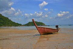 A longtail boat in Thailand. A longtail boat on the sea - Koh Kradan island, Thailand royalty free stock image
