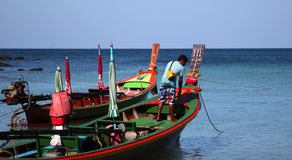 Longtail boat in Thailand. Traditional longtail boat moored on the waterfront of Thailand Stock Image