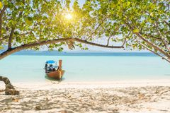 Longtail boat in Thailand with turquoise blue sea. In Asia Royalty Free Stock Images