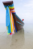 Longtail Boat in Thailand. Wooden Longtail Boat with towel and Flags at a Tropical Beach on Koh Samui in Thailand Stock Photos