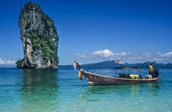 Longtail boat on tropical beach Stock Photography