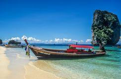 Longtail boat on tropical beach Royalty Free Stock Photos