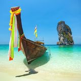 Longtail boat at the tropical beach of Poda island. Andaman sea, Thailand royalty free stock photography