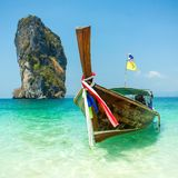 Longtail boat at the tropical beach stock photo