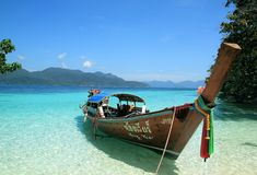 Longtail boat on a tropical beach, Thailand. Longtail boat a tropical beach, Andaman Sea, Thailand Royalty Free Stock Photo
