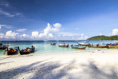 Longtail boat  and  Tropical beach with white sand Stock Image