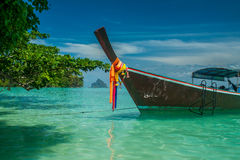 Longtail boat on a tropical island. Traditional longtail boat on Koh Kradan island, Trang Province, Thailand Stock Photo