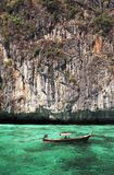 Longtail boat in turquoise waters Royalty Free Stock Photos