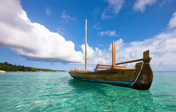 Longtail boat on the water. Kuramathi island stock photo