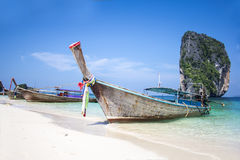Longtail boat on white sand beach and landmark at Po-da island. Krabi Province, Andaman Sea, South of Thailand Stock Photos