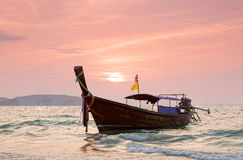 Longtail boats against a sunset. Stock Images