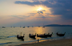 Longtail boats against a sunset Stock Images