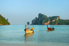 Longtail boats anchored at Ao Loh Dalum beach on Phi Phi Don Isl Royalty Free Stock Photo