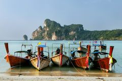 Longtail boats anchored at Ao Loh Dalum beach on Phi Phi Don Isl. And, Krabi Province, Thailand. Koh Phi Phi Don is part of a marine national park Royalty Free Stock Photos